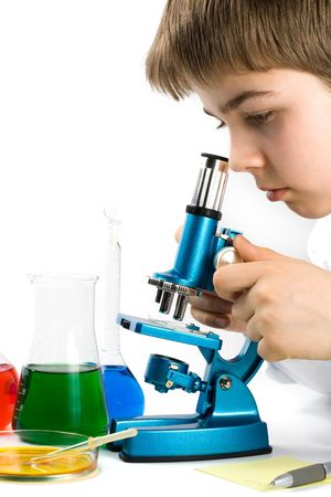 The boy with a microscope and various colorful flasks on a white background Stock Photo - 2997033