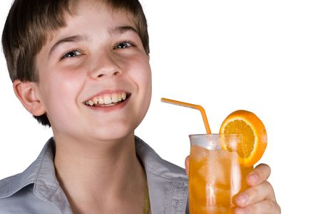 The boy with a glass of orange juice isolated on a white background. Clipping path included. photo