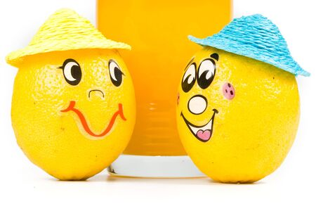 Cheerful little men from a fresh lemon and a juice glass isolated on a white background Stock Photo - 3031473
