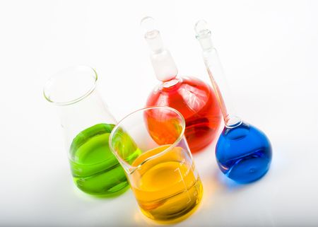 Various colorful flasks over white background Stock Photo - 3051100