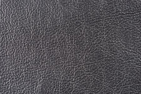 raw material: Natural qualitative black leather texture. Close up.