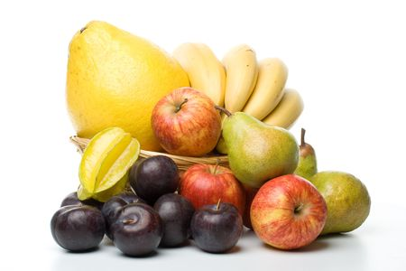 Various fresh fruits on a white background photo