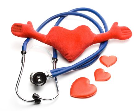 Heart and a stethoscope on a white background. Concept for cardiology. photo