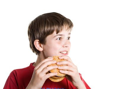 The boy eating a hamburger. Isolated on a white background. Stock Photo - 3149489