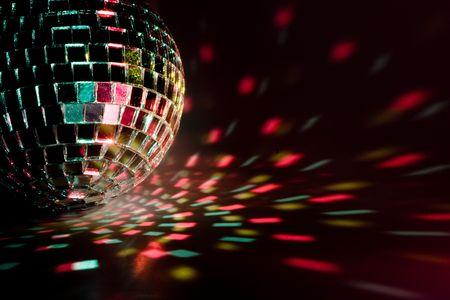 dancefloor: Disco ball light reflection background. Close up.
