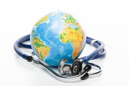 Globe with stethoscope on a white background photo