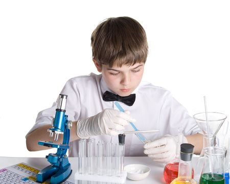 The boy with a microscope and various colorful flasks on a white background Stock Photo - 3182712