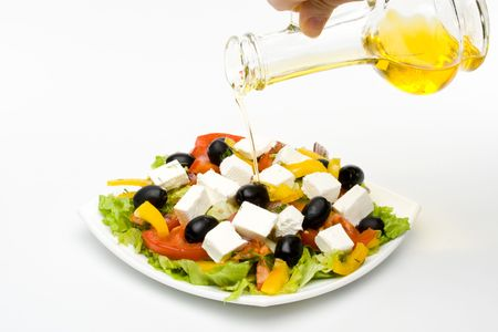 Appetizing greeak salad on a plate. Close up. Stock Photo - 3214075