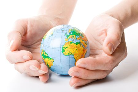 breakable: The globe in hands. Concept for environment conservation. Stock Photo