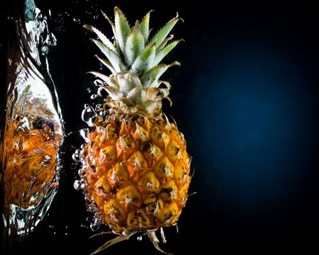 Fresh pineapple in water on a black/blue background with air bubbles Stock Photo - 3295172