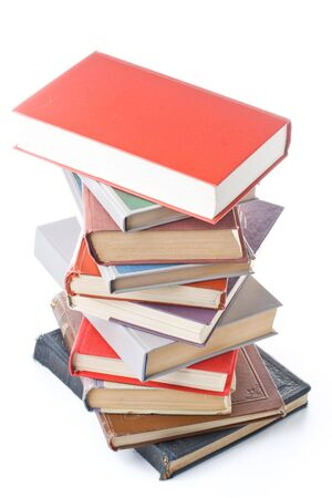 Pile of books isolated on a white background. Concept for