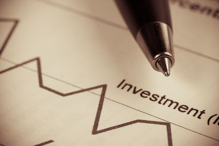 Pen and diagramm of investment. Close up. photo