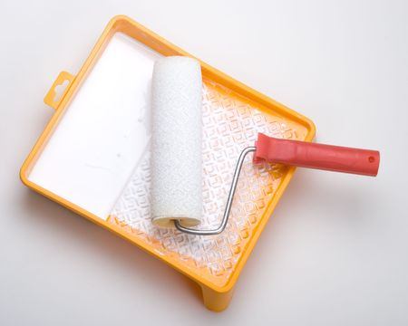 paintroller: Paint-roller and tray with paint on a white background