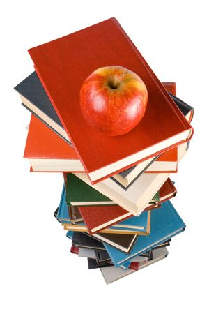 Pile of books and apple isolated on a white background.  Concept for Back to school photo