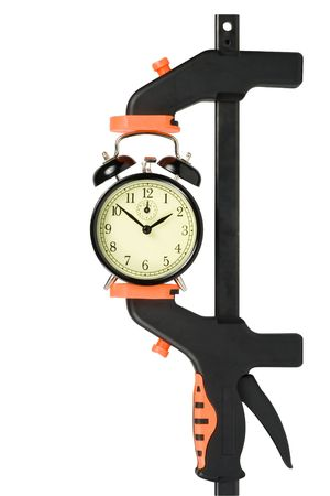 clamp: Alarm clock clamped in a manual clamp isolated on a white background. Clipping path included.
