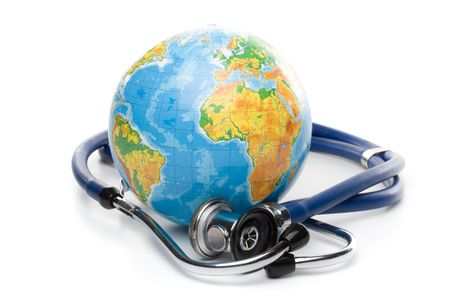 Globe with stethoscope on a white background photo