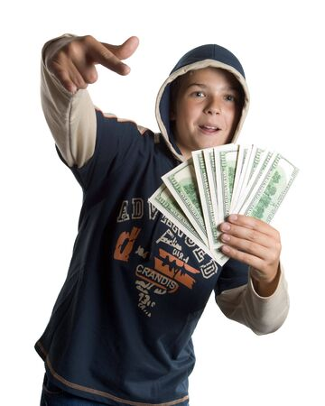 The young boy holds money in hands photo