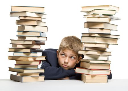 The boy and a pile of books on a white background. Concept for  photo