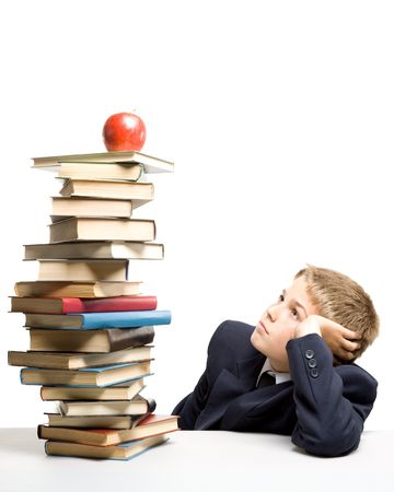 encyclopedias: The boy and a pile of books on a white background. Concept for