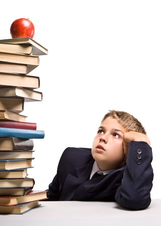 The boy and a pile of books on a white background. Concept for  Stock Photo - 3391805