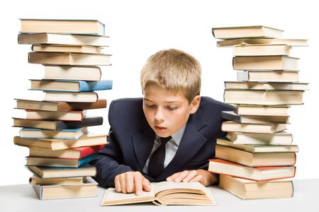 The boy and a pile of books on a white background. Concept for Stock Photo - 3406053