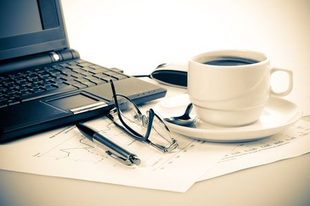 Pen, chart, notebook, eyeglasses and cup of coffee.  still-life. photo