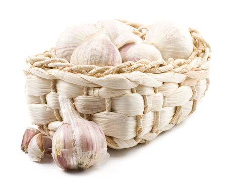 aftertaste: Fresh garlic on a white background. Close up.