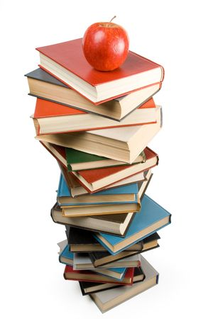 Pile of books and apple isolated on a white background. Concept for Back to school. Clipping path included. photo