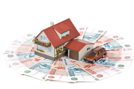 Miniature House and Money. Buying house concept photo