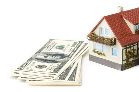 downpayment: Miniature House and Money. Buying house concept