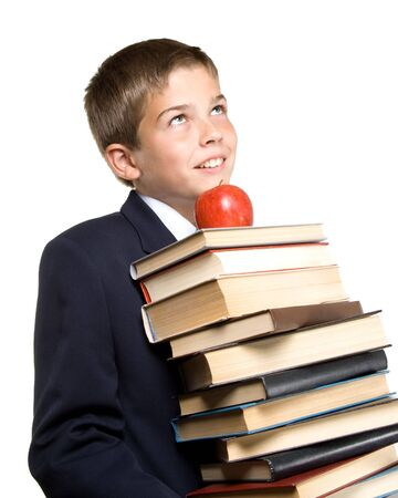 The boy and a pile of books on a white background. Concept for Back to school photo