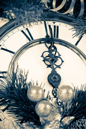 New Year's decoration with an antique clock and a firtree branch Stock Photo - 3582603