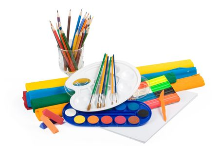 Water colour paints, pencils and brushes on a white background photo