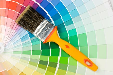 redecorating: Brushes on a background from colour guide Stock Photo