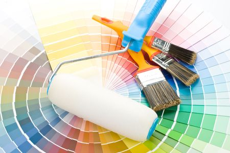 paintroller: Brushes and paint-roller on a colour guide