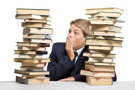 encyclopedias: The boy and a pile of books on a white . Concept for Back to school Stock Photo