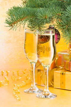 alcohol cardboard: Decoration with an  firtree branch, gift boxes and champagne glasses Stock Photo