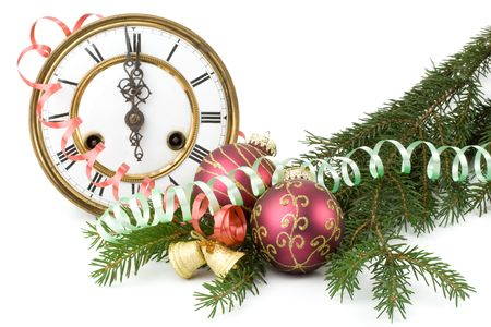 New Years decoration with an antique clock and a firtree branch photo