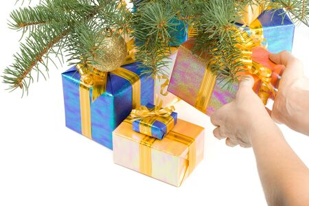 Various gift boxes and fur-tree branch on a white background Stock Photo - 3702287
