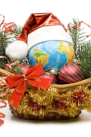 Decoration with an  firtree branch, globe and toys on a white background Stock Photo - 3702272