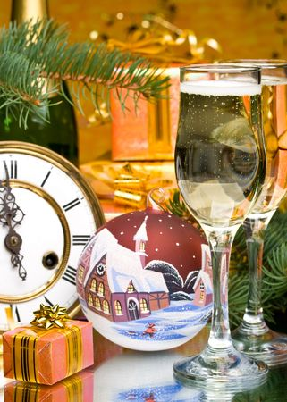 Decoration with an antique clock, firtree branch, gift boxes and champagne glasses Stock Photo - 3743340