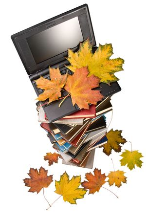 Pile of books, notebook and autumn leaves on a white background. Stock Photo - 3743288