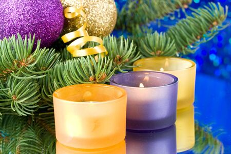 Decoration with an  firtree branch, candles and toys Stock Photo - 3775522