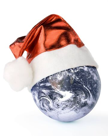 Santas red hat and globe on a white background photo