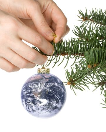 Decoration with an  firtree branch, globe and toys on a white background
