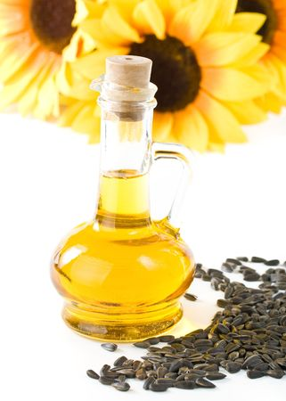 sunflower seeds: Sunflower and vegetable oil in a bottle on a white background
