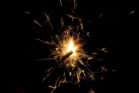 Christmas sparkler on a black background photo