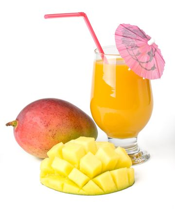 Fresh, juicy, appetizing mango and glass of fresh juice with a straw, decorated with a decorative umbrella on a white background photo