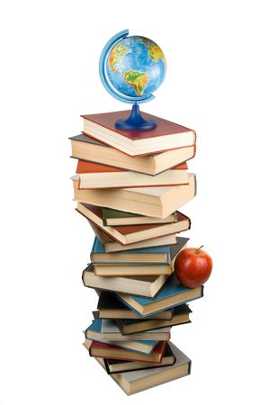 Pile of books, globe and apple isolated on a white background.  Concept for Back to school photo