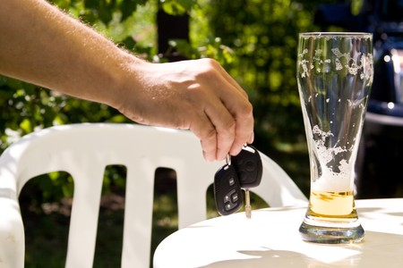 Drinking and Driving - Car keys and alcohol photo